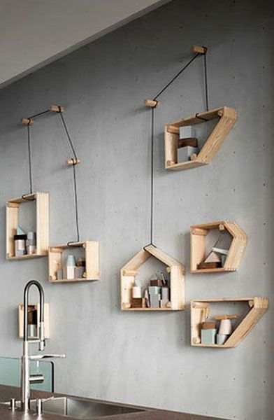 wooden floating shelves with wire, grey wall, sink