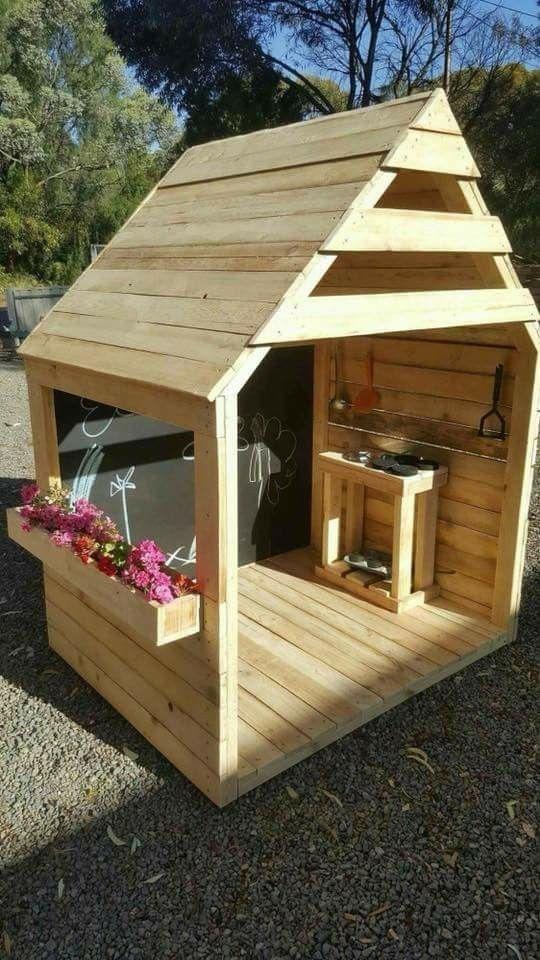 wooden garden tent with shelves, blackboard, flower pot near the window