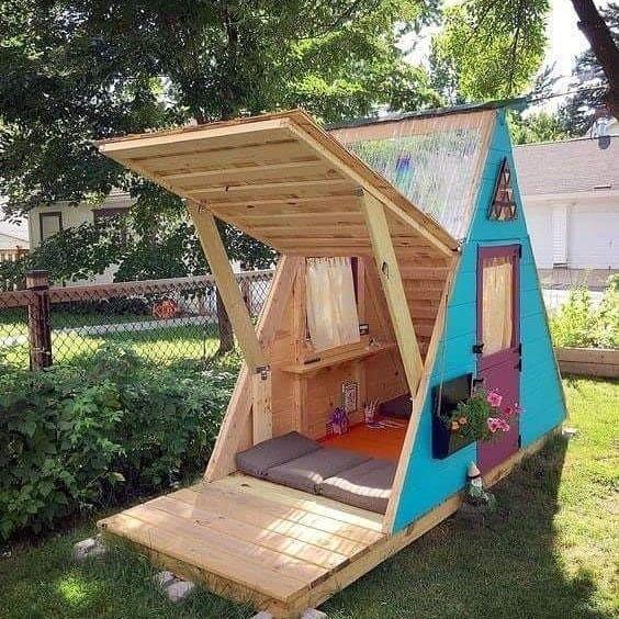 wooden tent with doors, windowspillows, bed, orange floor