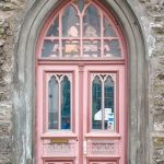 Anique Doors With Soft Pink Paints, Glasss Window On The Doors And The Top Of The Arch