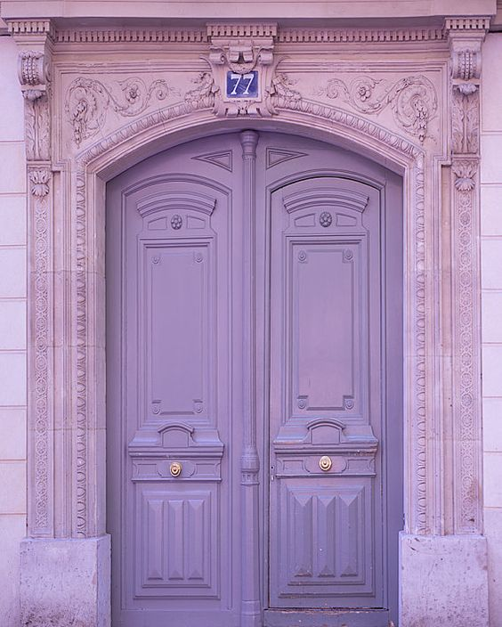 antique door in soft purple, pink detailed arch frame