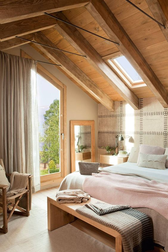 attic bedroom, wooden floor, grey wall, wooden ceiling, wooden beam, wooden bench, wooden chair, bed, large glass door, grey curtain