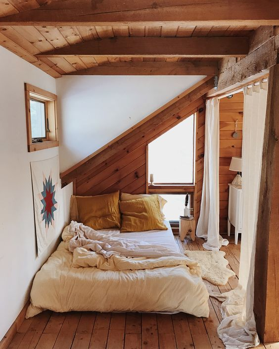 attic bedroom, wooden floor, white wall, wooden wall, wooden ceiling, white bedding, white curtain
