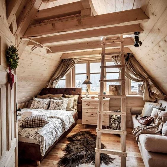 attic bedroom, wooden floor, wooden sloping wall, stair, bed, sofa, wooden cabinet, window