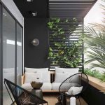 Balcony, Brown Wooden Floor, Grey Wall, Clear Glass Window, Wooden Bench With White Cushion, Black Rattan Cair, Black Coffee Tables, Pergola On The Ceiling