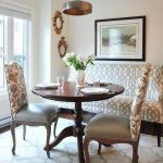 Banquette, Wooden Floor, Brown Ru, Patterned Sofa And Chairs, White Wall, Copper Pendant, Wooden Round Table, Glass Window