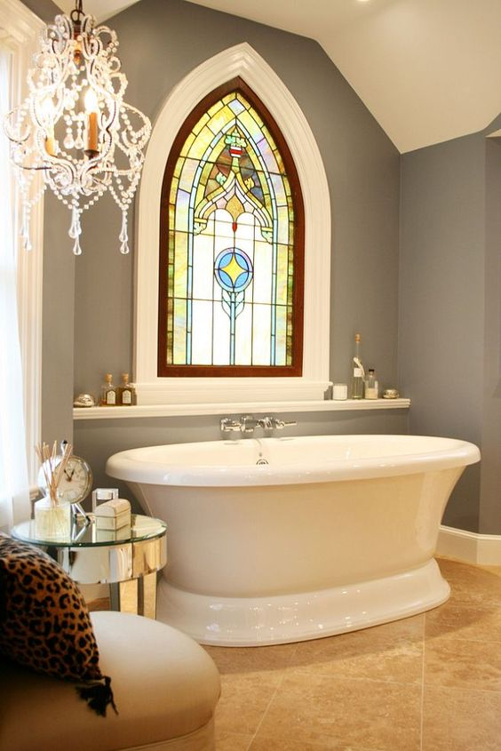 bathroom, brown marble floor, grey wall, white ceiling, whie tub, white floating shelves, chairs, side table