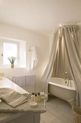 bathroom, grey floor, grey curtain, grey tub, grey wooden vanity