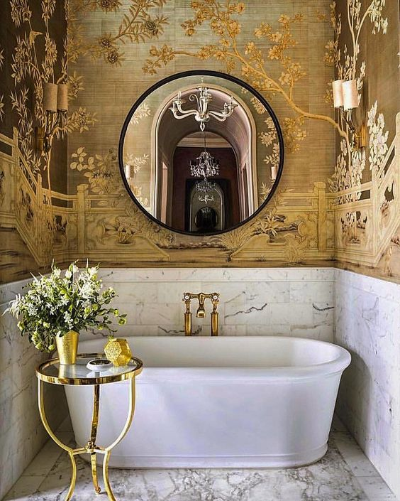 bathroom, marble floor, white marble wall, golden wallpaper, white tub, golden rimmed side table, round mirror