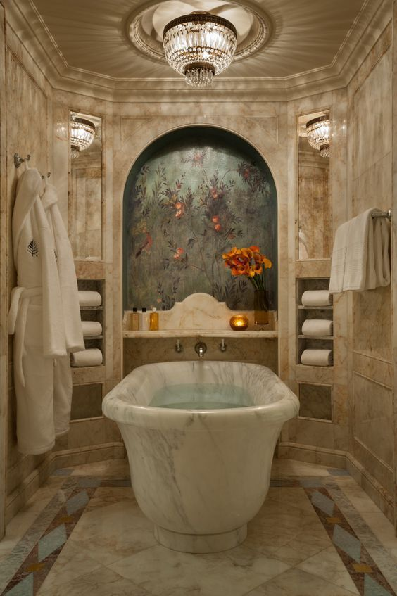 bathroom, marmer floor and wall, built in shelves, chandelier, white marble tub