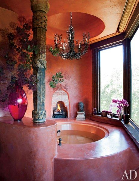 bathroom, pink marble surface, round ceiling, chandelier, glass window, round tub