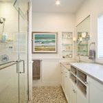 Bathroom Storage Cabinets Glass Shower Doors Mosaic Floor Tile White Cabinet White Vanity Undermount Sink Wall Mirrors Glass Built In Shelves Window Shutter Gray Countertop