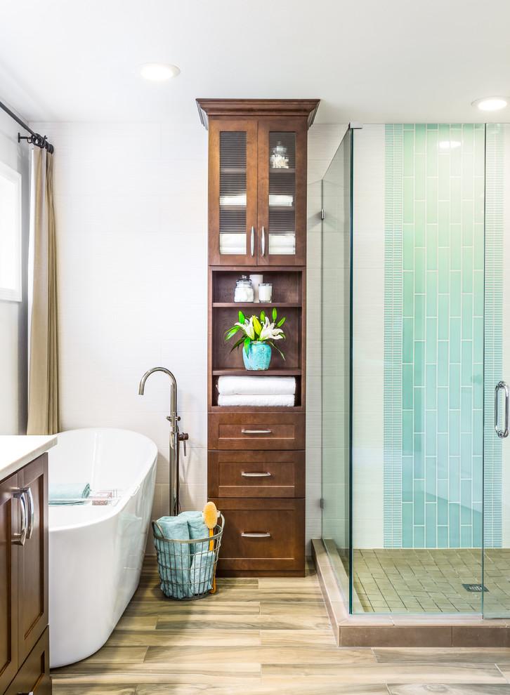 bathroom storage cabinets glass shower doors tub filler basket window acrylic freestanding bathtub blue wall tile curtains vanity floor tile