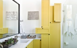 bathroom storage cabinets yellow cabinet yellow floating vanity white countertop glass shower door wall mirror double sink wall mounted faucets dark floor tile toilet