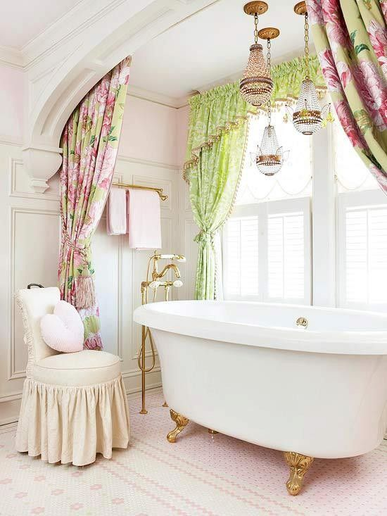 bathroom, white patterned tiny floor tiles, white ceiling, arche, flowery curtain, green curtain on the window, white tub, white chair, clear glass pendant