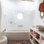 Bathroom, White Textured Wall, White Built In Textured Bath Tub, Red Rug, White Built In Textured Shelves, Wooden Beams Ceiling