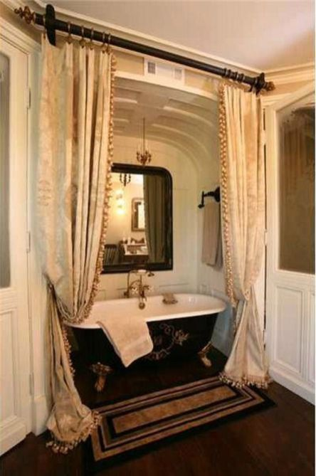 bathroom, wooden floor, white wall, white arch, black tub, golden curtain on black rod, black mat