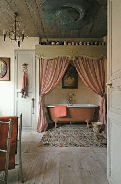 bathroom, wooden floor, wooden ceiling, pink curtain, pink tub, white wall, door, chandelier