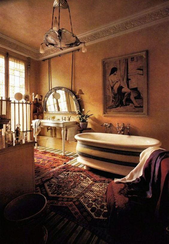 bathroom, yellow wall, yellow ceiling, yellow floor, red rug, white tub, white vanity, half round mirror, marble chandelier