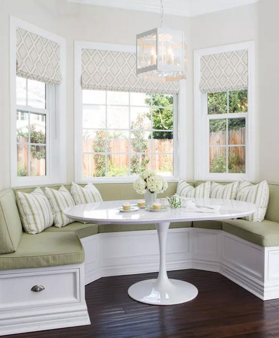 bay, white wooden bench, dark wooden floor, white table, white wall, white pendant, soft green cushion, striped pillows