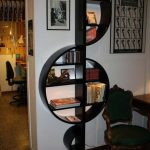 Black Wooden Bookshelves In The Shape Of G Key