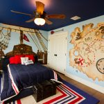 Bronze Ceiling Fan With Light Blue Ceiling Wall Mural White Doors Blue Walls Colorful Rug Blue Bedding Black Trunk Window Shutter