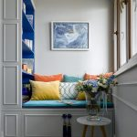 Built In Library With Grey Bench With Drawers, Cushion, Shelves In Blue, Pillows