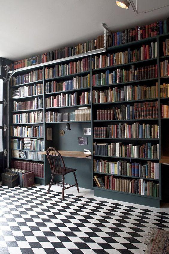 dark bookshelves, plaid floor, floating foldable table, white ceiling