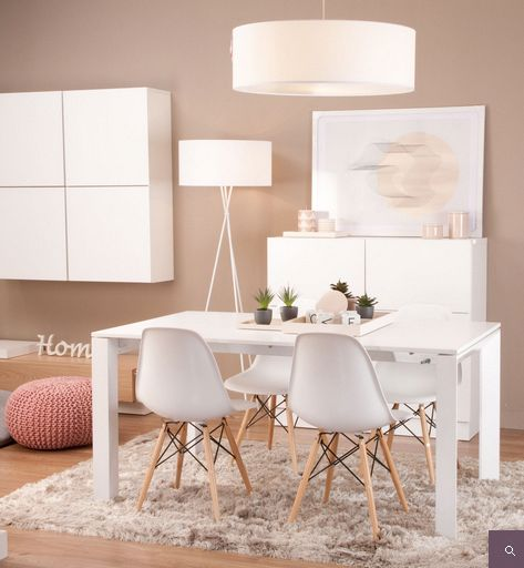 dining room, wooden floor, grey rug, white rectangle table, white midcentury modern chair, beige wall, white round pendant, pink ottoman, white cabinet, white floating cabinet