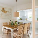 Dining Room, Wooden Floor, Wooden Table Rattan Chairs, Brown Pendant, White Wall, White Kitchenette