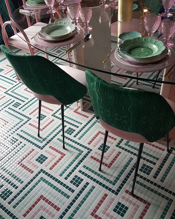 dinning room, tiny lfoor tiles in colors in particular patterns, glass table, green pink chairs, pink chairs