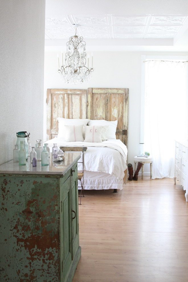 diy headboard crystal chandelier wooden headboard white bedding pillows white stools window white curtains vintage green cabinet chairs