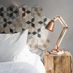 Diy Headboard Hexagonal Wall Tile Rose Gold Industrial Table Lamp Wooden Bedside Table White Bedding White Pillows Gray Wall Window