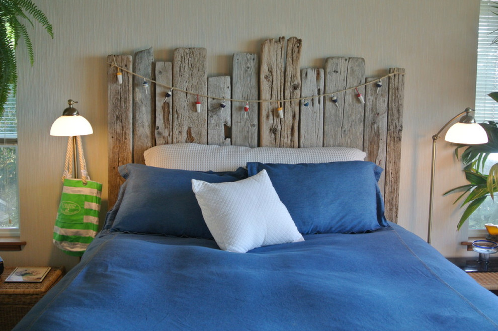 diy headboard wooden beach headboard blue bedding blue pillows wall sconces windows shutters hooks rattan side table indoor plants