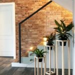 Entrance, White Plant Supports, Wooden Floor, Open Brick Wall, White Door, Grey Mat
