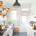 Galley Kitchen, Grey Floor, White Cabinet, White Wall, Floating Shelves, Black Pendant