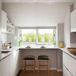 Galley Kitchen, Wooden Floor, White Bottom Cabinet, White Floating Shelves, Window, Black Stools