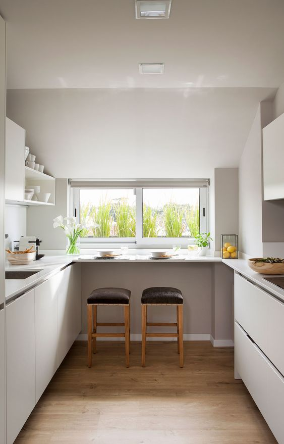 galley kitchen, wooden floor, white bottom cabinet, white floating shelves, window, black stools