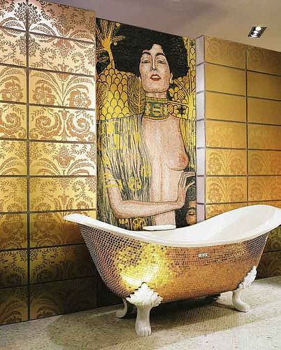 golden mosaic tiles, white claw feet, golden wall with patterned, egypt painting