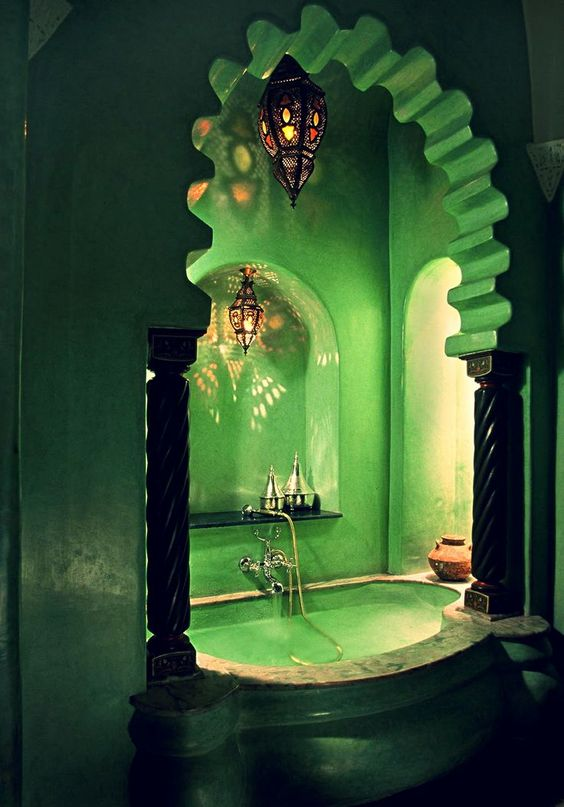 green bathroom, green wall, green tub, green jagged arch, moroccan pendants