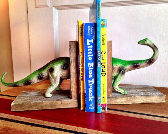 green dinosaur book ends with wooden pedestal