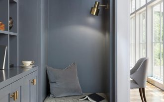 grey built in nook with drawers, cushion, book shelves on the side, sconce