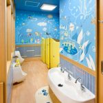 Kids Toilet, Brown Wooden Floor, Blue Wallpaper, Yellow Door, Wooden Vanity With White Top, Blue Wainscoting