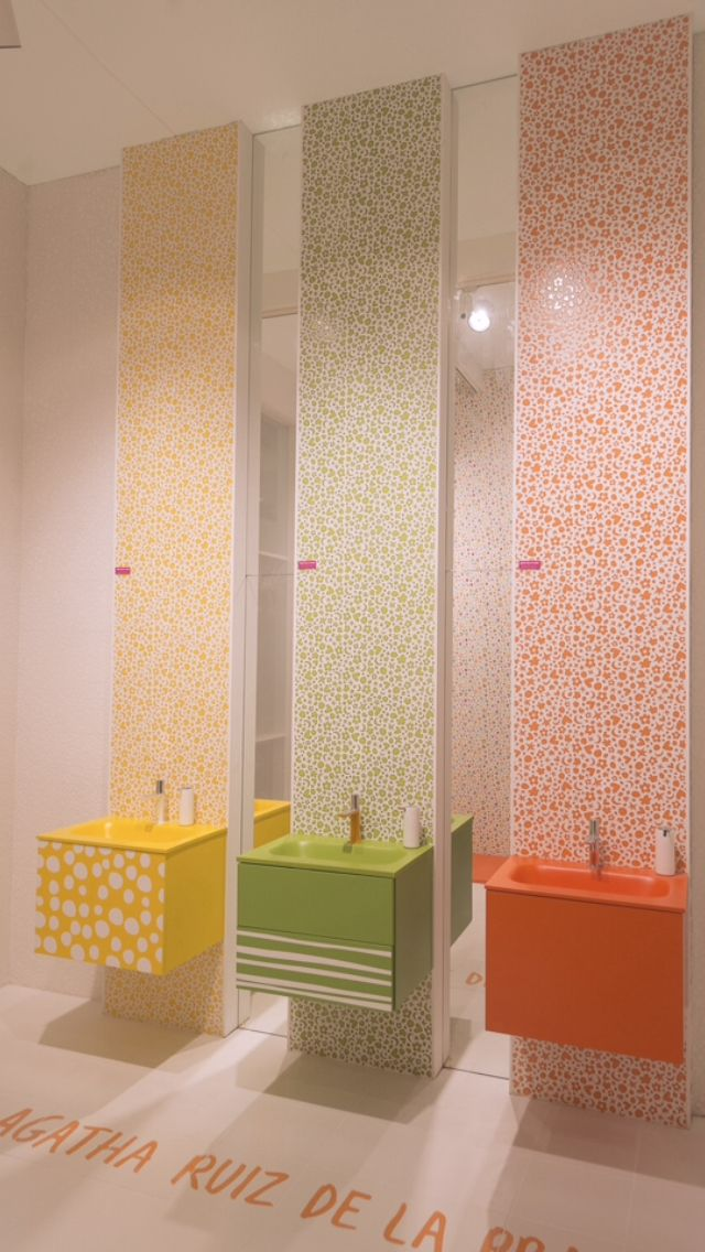 kids toilet, orange, yellow, green floating vanity, beige floor, beige wal