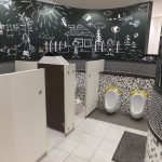 Kids Toilet, White Floor Tiles, Lack White Wall Tiles, White Low Partition, Black Art Board With White Painting