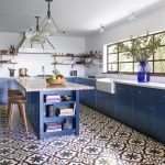 Kitchen, Blue Bottom Cabinet, White Marble Top, Patterned Floor Tiles, Blue Wooden Island, Grey Marble Top, White Wall, White Ceiling, Pendant, White Subway Wall Tiles