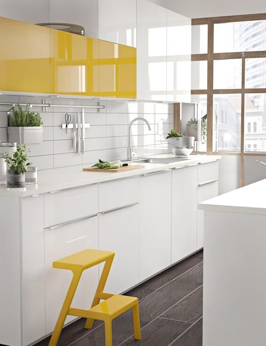 kitchen, grey floor, white bottom cabinet, white yellow upper cabinet, white kitchen top, white backsplash, white island