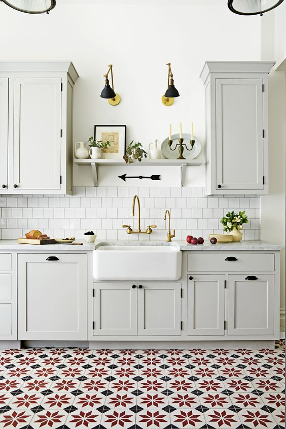 kitchen, white square backsplash, white wall, white bottom and upper cabinet, patterned floor tiles, white apron sink, white marble top