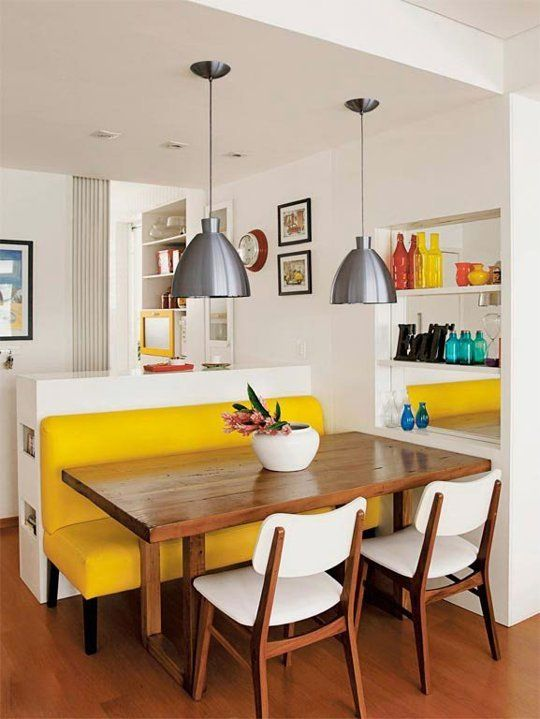 kitchen, wooden floor, white chairs, yellow sofa, wooden table, white kitchen, silver pendant, shelves