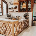 Kitchen, Wooden Floor, Wooden Patterned Kitchen Isand, White Plaid Backsplash, Arch Window, Stained Glass Window, Rattan Pendants, Floating Shelves